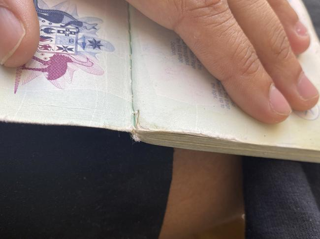 The passport appears to have a small amount of visible damage on one page.