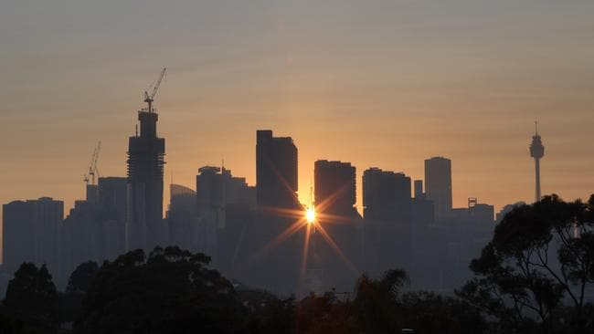 The Sydney skyline as seen from Balmain today as winds blow smoke from bushfires over the CBD. Picture: AAP