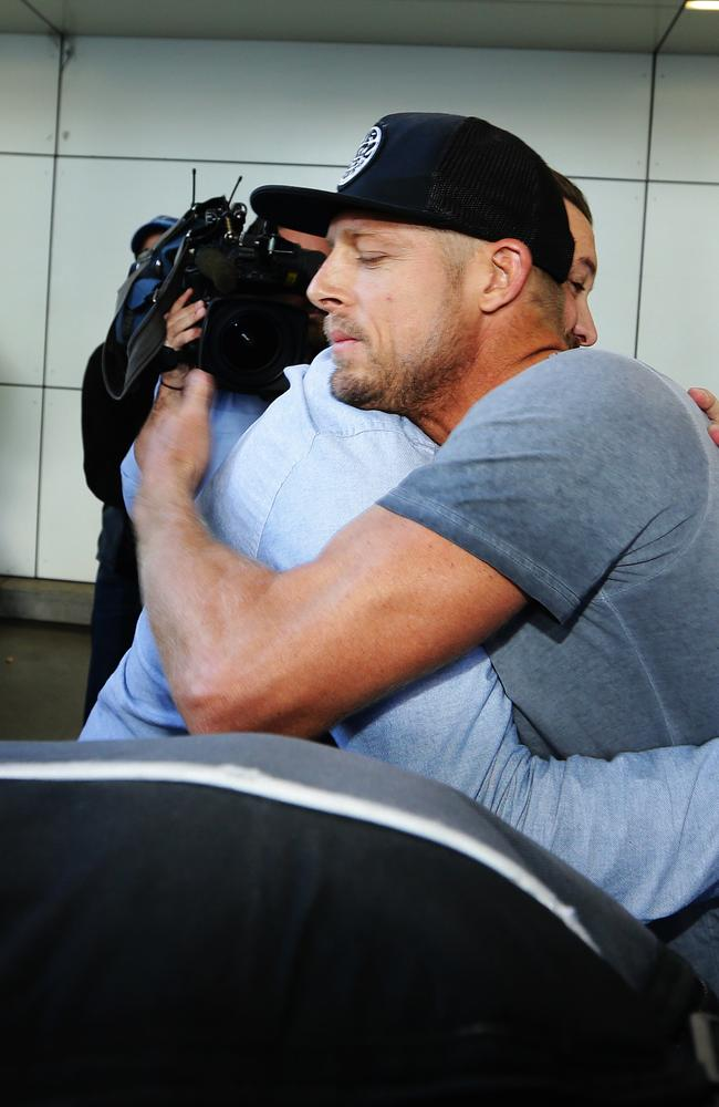 Australian surfer Mick Fanning arrives at Sydney Airport after his shark encounter in South Africa. Pic Brett Costello.