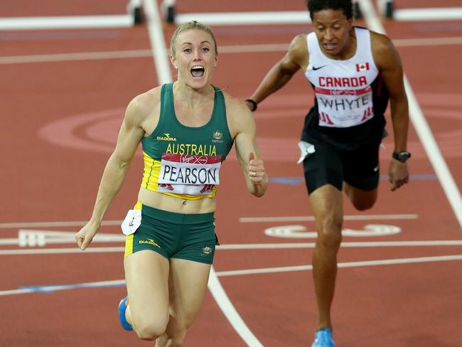 Sally Pearson overcame all the distractions to cross the line first in Glasgow. Picture: Adam Head.