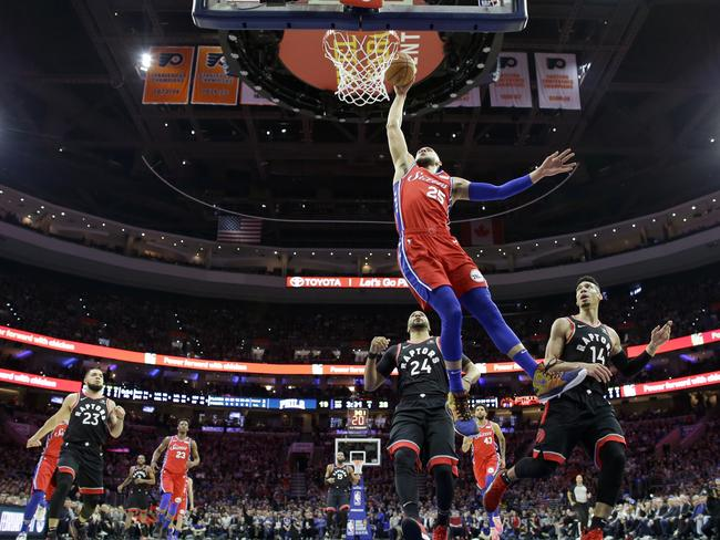 Ben Simmons goes up for a dunk against the Toronto Raptors.