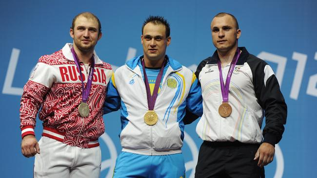 (L-R) Alexandr Ivanov of Russia, Ilya Ilyin of Kazakhstan and Anatoli Ciricu of Moldova have all been stripped of their medals won at the London 2012 Olympic Games.