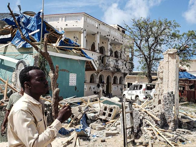 A man passes in front of the rubble of the popular hotel in Kismayo. Picture: AFP