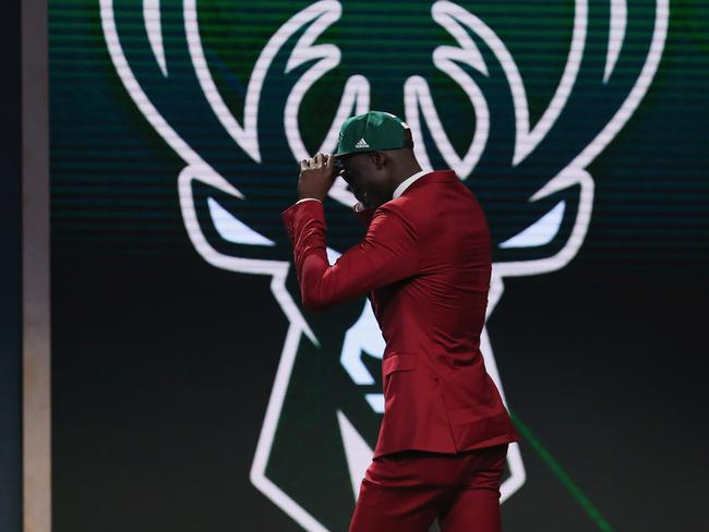 Thon Maker walks on stage after being drafted 10th overall by the Milwaukee Bucks.