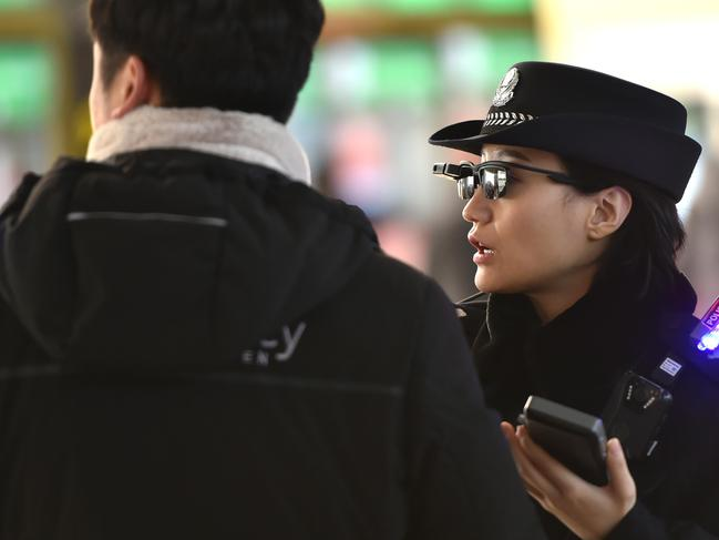 The glasses feed a stream of images to a hand-held device which contains a database of suspects. It is able to sort through them at a rate of 10,000 faces in one-tenth of a second. Picture: AFP