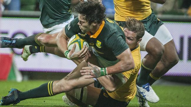 Wallabies captain Michael Hooper pulls off a try-saving tackle on Springbok centre Jan Serfontein.
