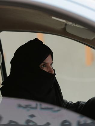 A woman drives in Riyadh as part of a campaign to defy the kingdom's ban on women driving. Picture: AP Photo/Hasan Jamali, File.