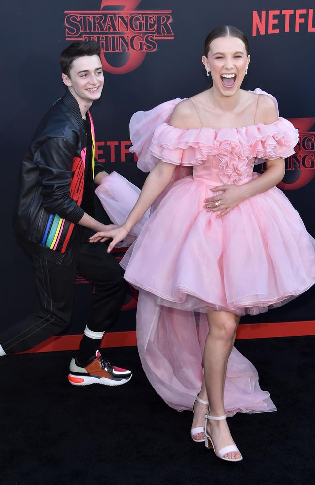 Noah Schnapp and Millie Bobby Brown on the black carpet. Picture: AFP