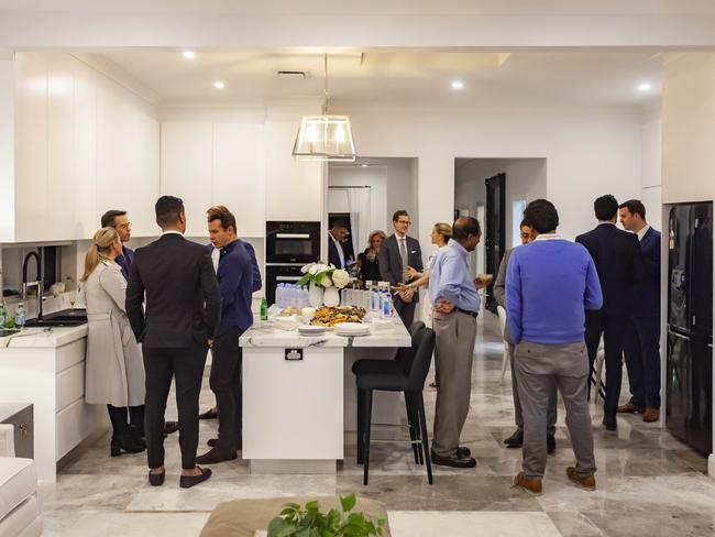 The party (above) at 133 O'Sullivan Rd, Bellevue Hill (below) a month ago.