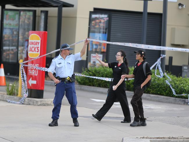 Hungry Jack's staff are released by police hours after a woman was shot dead in West Hoxton. Picture: Craig Greenhill
