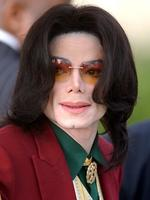<p>In this March 17, 2005 file photo, Michael Jackson arrives at the Santa Barbara County Courthouse in Santa Maria, Calif. Discovery Channel International has indefinitely postponed the broadcast of a show purporting to re-enact Michael Jackson's autopsy, the company announced Friday, Dec. 31, 2010. (AP Photo/Michael A. Mariant, File)</p>