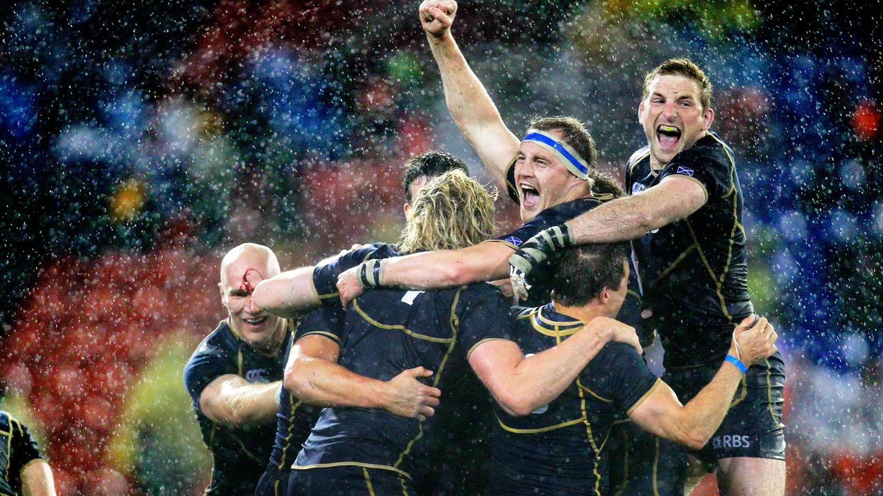 Scotland players celebrate their win over the Wallabies at Hunter Stadium, Newcastle.