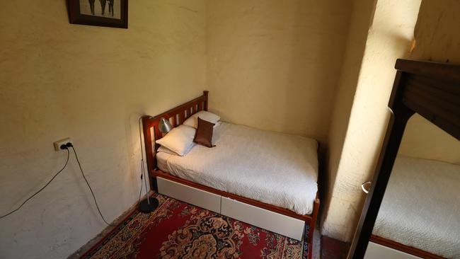 One of the prison cells has been converted into a guest bedroom for the vendor's in-laws. Picture: Tait Schmaal.