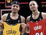 FILE - In this Dec. 29, 2018, file photo, Portland Trail Blazers guard Seth Curry, left, and his brother, Golden State Warriors guard Stephen Curry, exchange jerseys after an NBA basketball game in Portland, Ore. The Curry brothers are returning to their hometown of Charlotte, N.C, for the NBA All-Star weekend. Stephen, a two-time league MVP, will join younger brother Seth in the 3-point shootout on Saturday night at the Spectrum Center and then play in his sixth straight All-Star game on Sunday. (AP Photo/Steve Dykes, File)