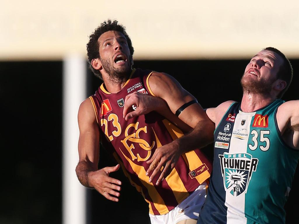 WAFL - Peel Thunder vs Subiaco Lions at Bendigo Bank Stadium, Mandurah. Subiaco's Zac Clarke flies over Peel's Michael Apeness at the bouncedown Picture: Daniel Wilkins 19/05/2018