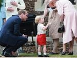 Prince George of Cambridge talks to Queen Elizabeth II outside the Church of St Mary Magdalene on the Sandringham Estate for the Christening of Princess Charlotte of Cambridge on July 5, 2015 in King's Lynn, England. Picture: Getty
