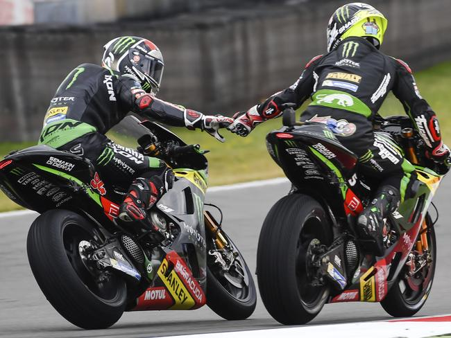 Johann Zarco, right, celebrates with teammate Jonas Folger after winning pole.