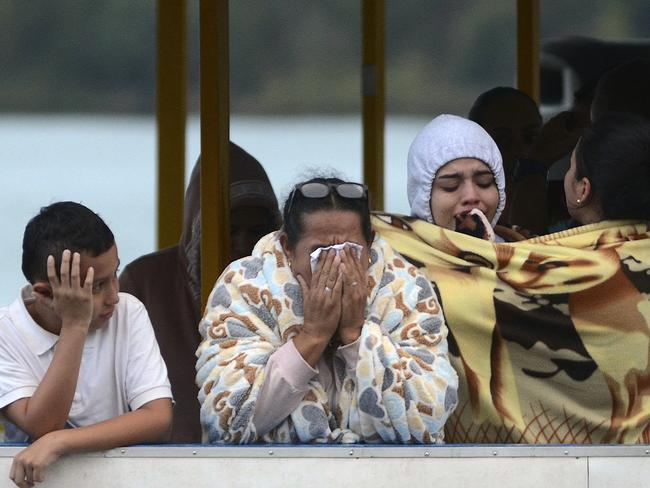 People who survived the capsizing of a ferry cry as they wait for more information about their missing friends and relatives. Picture: AP
