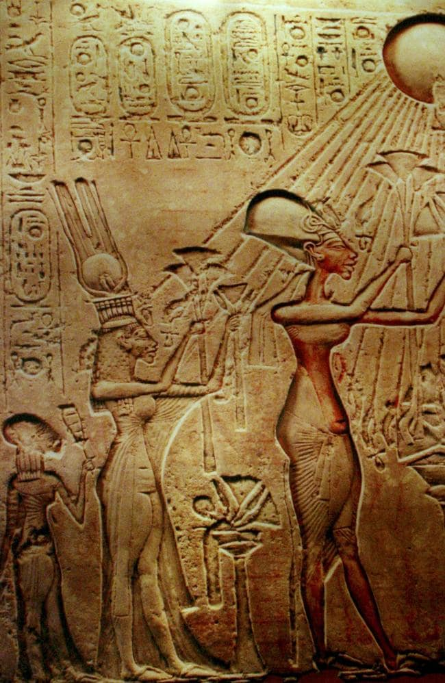 A stela at the Egyptian museum in Cairo showing Pharaoh Akhenaten, his Queen Nefertiti and their children worshipping the sun in the more natural artistic style of the time. Picture: AP