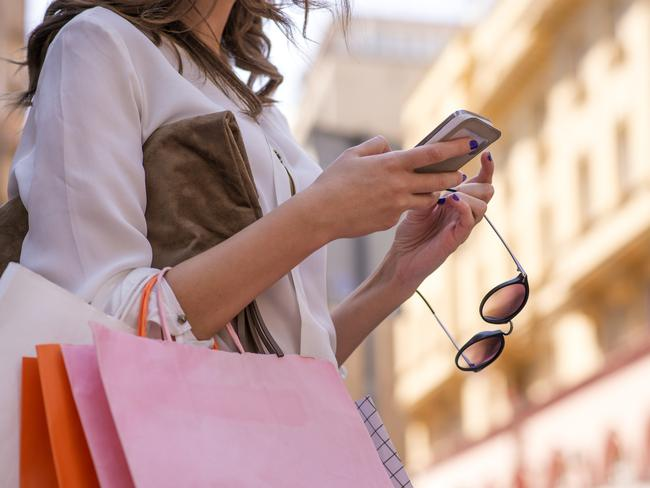 iPhone users spend hundreds of dollars each month on clothing, technology and cosmetics.