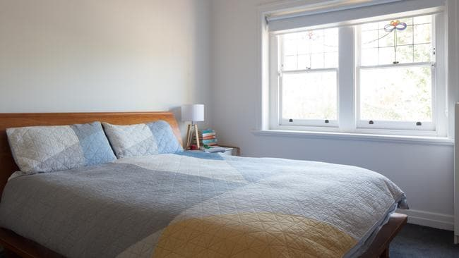 One of the original bedrooms, with its charming leadlight window.
