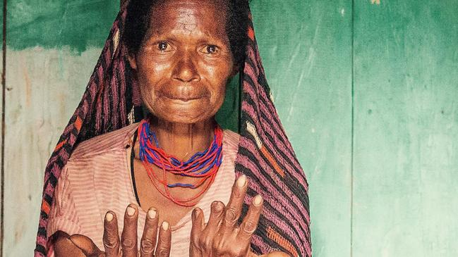 Female members of the tribe can be identified by their amputated fingers.