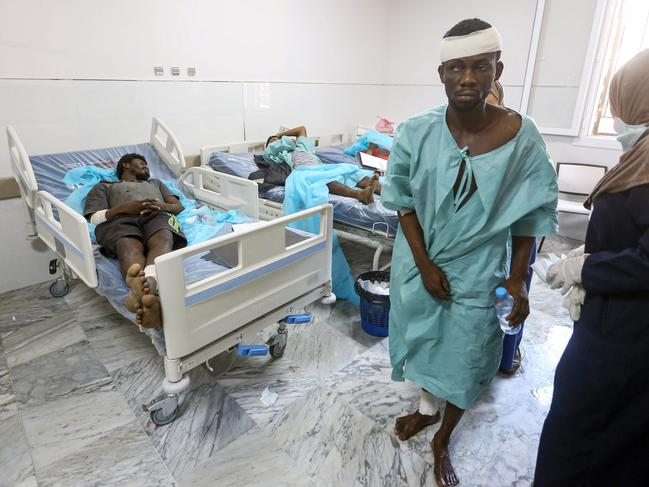 An injured migrant at a hospital in Tripoli, following an air strike on a nearby building that left dozens killed the previous night. Picture: AFP