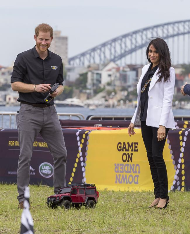 Meghan could be heard trying to convince Harry to leave the game, but he wouldn't cop it. Picture: AAP Image/Craig Golding