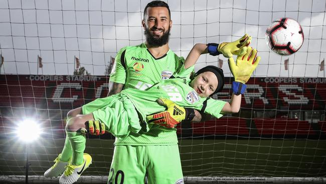 Adelaide United supporter Ace Kounavis with Reds goalkeeper Paul Izzo at Hindmarsh Stadium. Picture: Sarah Reed