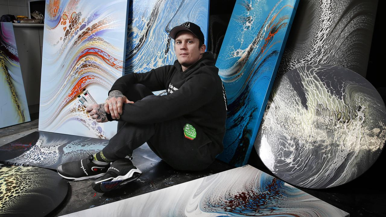 Dayne Beams surrounded by some of his works art at his Health of Mind Art studio. Picture: David Caird