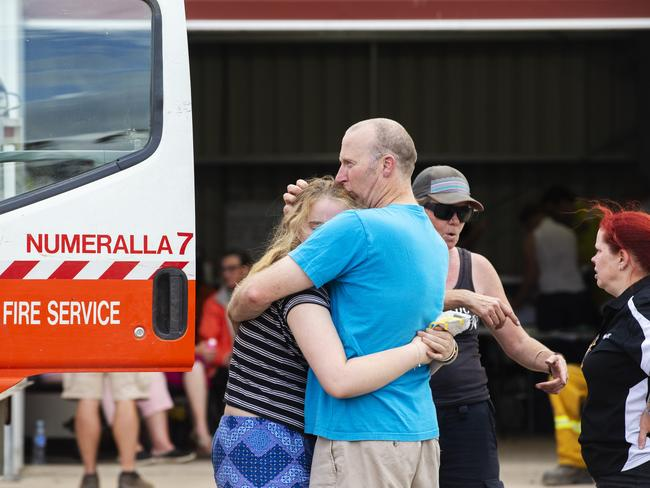 People hug at Numeralla Rural Fire Brigade near the scene of the crash. Picture: Jenny Evans/Getty Images