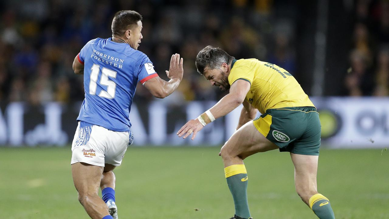 Adam Ashley-Cooper lines up Samoa's Tim Nanai-Williams early in the first half.