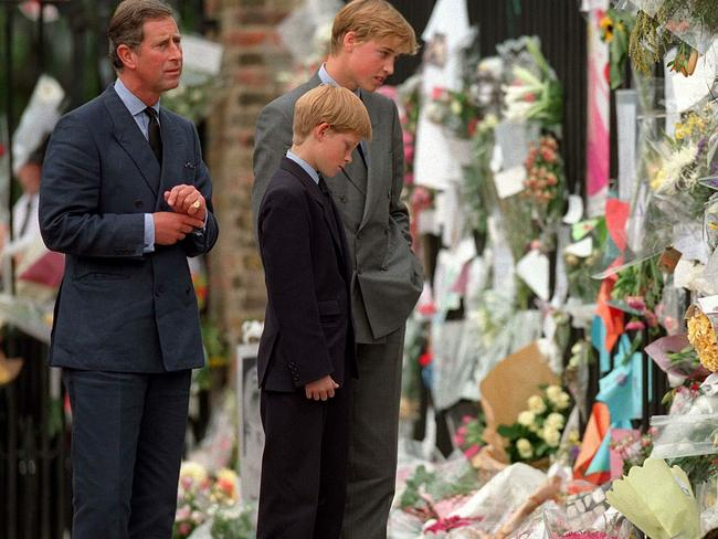 The Prince of Wales, Prince William and Prince Harry look at floral tributes to Diana, Princess of Wales outside Kensington Palace on September 5, 1997 in London, England. Picture: Getty