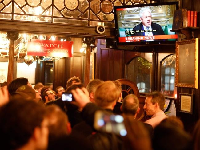 Drinkers watch a television screen in a pub in Whitehall as John Bercow, Speaker of the House declares that Prime Minister Theresa May's Brexit deal was defeated by 149 votes in a historic parliamentary vote. Picture: AFP