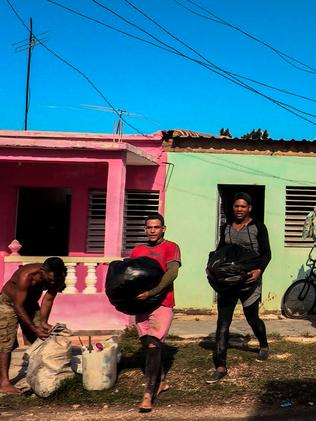 Cubans carry their belongings to protect them from Hurricane Irma. Picture: AFP