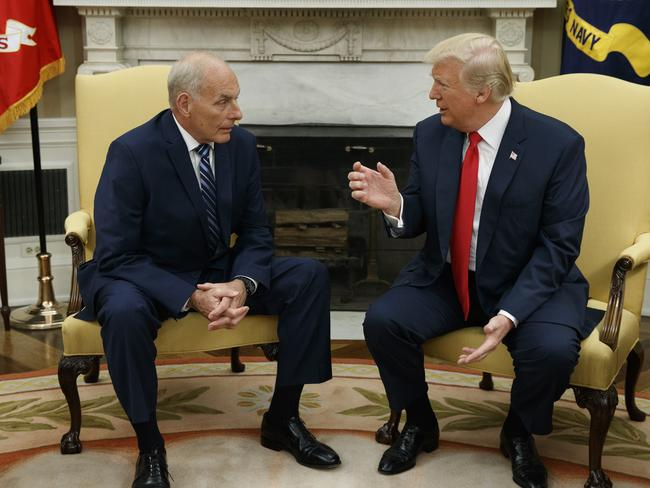 President Donald Trump talks with new White House Chief of Staff John Kelly after he was privately sworn in during a ceremony in the Oval Office yesterday. Picture: Evan Vucci/AP