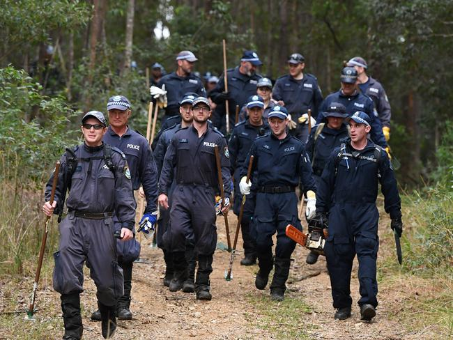Members of the NSW Public Order and Riot Squad leave bushland in Kendall on the NSW mid-north coast. Picture: Joel Carrett/AAP