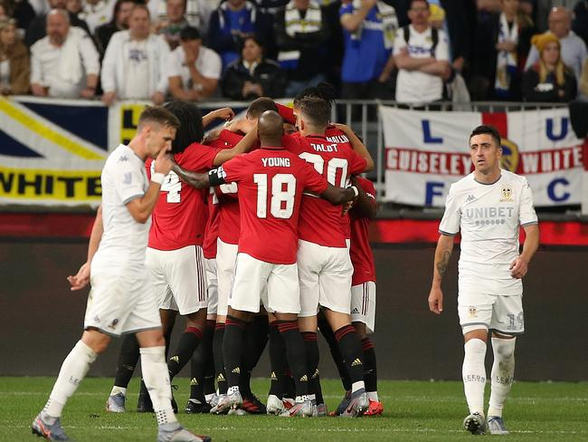 Manchester United celebrate their huge friendly win.