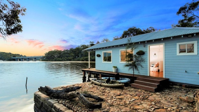 Newly renovated, this south Sydney boat house has its own kitchenette and a deck that drops right down onto the waterfront. Picture: Supplied