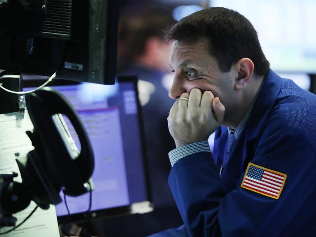 Dark clouds: AMP Economist Shane Oliver said there are some bright spots on the economic horizon but fears about Europe and the prospect of a US trade war with China are keeping investors nervous. Picture: Spencer Platt/Getty Images/AFP