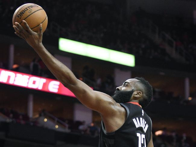 James Harden drives to the basket past Cleveland Cavaliers guard Collin Sexton.