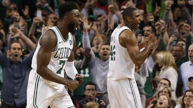 The Boston Celtics celebrate beating the Toronto Raptors for their 12th straight win. (AP Photo/Winslow Townson)