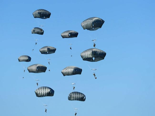 Incoming ... US Paratroopers from the 4/25th Infantry Division descend to the drop zone. Picture: Ian Hitchcock/Getty