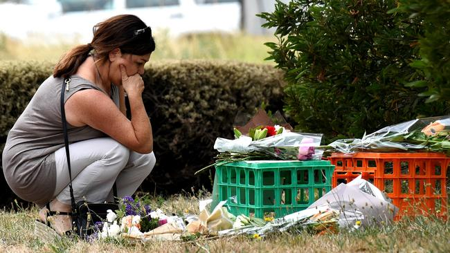 Tributes have been laid in Bundoora, near the Polaris town centre shopping complex. Picture: Nicole Garmston