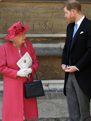 Britain's Queen Elizabeth II (L) and Britain's Prince Harry. Picture: AFP