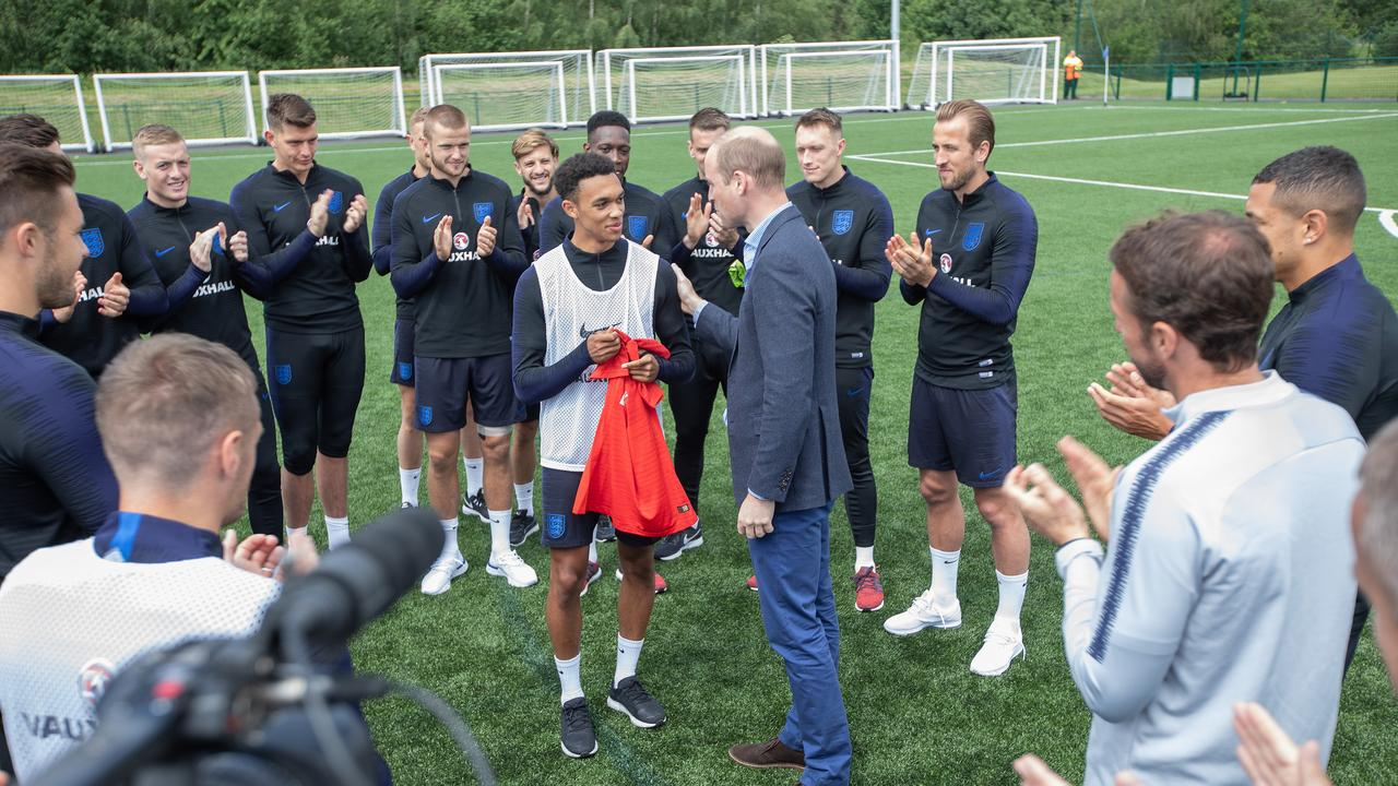 One for the royal watchers: Prince William, Duke of Cambridge, giving young star Trent Alexander-Arnold his debut England jersey.