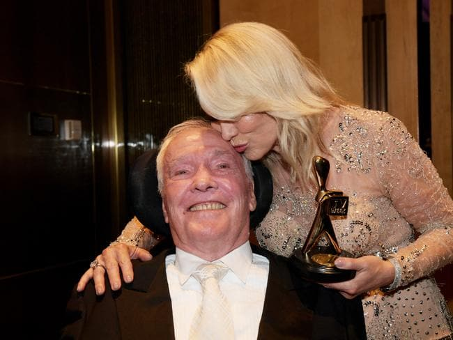 Kerri-Anne Kennerley and John Kennerley pose for photographs with her Gold Logie for the TV Week Logie Hall of Fame. Picture: AAP