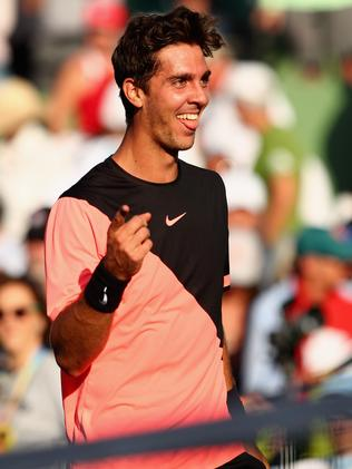Thanasi Kokkinakis celebrates after beating Roger Federer last year.