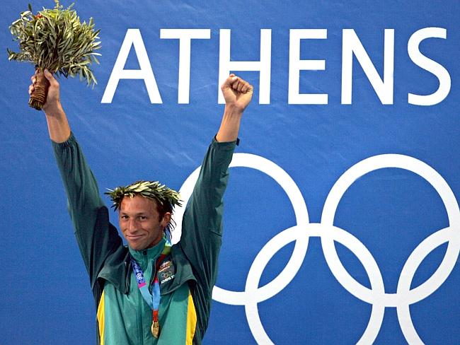 Ian Thorpe of Australia posing on the podium after winning the men's 200m freestyle gold medal at the 2004 Olympic Games in Athens / Picture: AFP