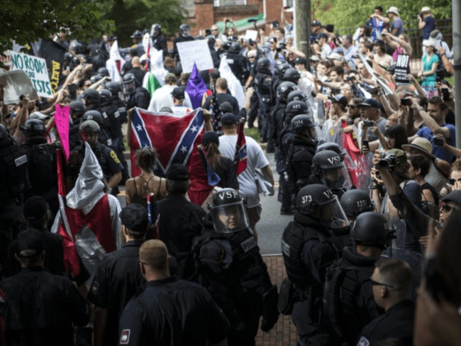 Members of the KKK were escorted out of a planned rally last month in Charlottesville. Photo: Chet Strange/Getty.